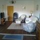 Wohnraum mit Kaminofen und Fernseher